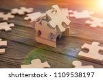 the house is made up of pieces... | Shutterstock . vector #1109538197