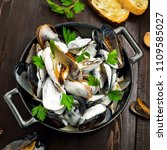 mussels in a white wine and... | Shutterstock . vector #1109585027