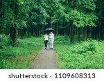 attractive couple under an...   Shutterstock . vector #1109608313