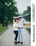 attractive couple in the rain...   Shutterstock . vector #1109608337