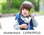 cute boy with headphones and... | Shutterstock . vector #1109639513