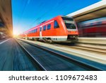 high speed red train in motion... | Shutterstock . vector #1109672483