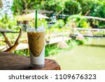 iced coffee in plastic cup on...   Shutterstock . vector #1109676323