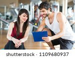 woman doing stretching in a gym | Shutterstock . vector #1109680937