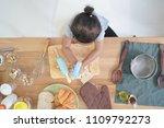 top view little girl cooks in... | Shutterstock . vector #1109792273