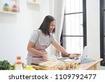 woman cooking with receipt on... | Shutterstock . vector #1109792477