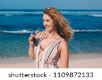 portrait of woman on the beach... | Shutterstock . vector #1109872133