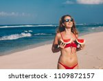 young woman in red bikini with... | Shutterstock . vector #1109872157