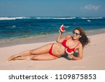 young woman in red bikini with... | Shutterstock . vector #1109875853