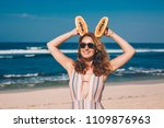 young woman with papaya on the... | Shutterstock . vector #1109876963