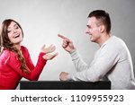 Small photo of Happy couple talking and laughing on date. Smiling girl and guy having conversation. Amusing man making woman laugh. Good relationship.