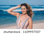 young woman on the beach... | Shutterstock . vector #1109957537