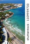 Small photo of Aerial drone bird's eye photo of famous celebrity wavy sandy beach of Astir or Asteras in south Athens riviera with turquoise clear waters, Vouliagmeni, Greece