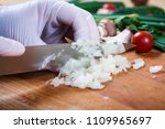 woman chopping garlic on wooden ... | Shutterstock . vector #1109965697