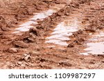 wheel trace on road  puddle and ... | Shutterstock . vector #1109987297