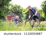 an adult hipster son and senior ... | Shutterstock . vector #1110054887