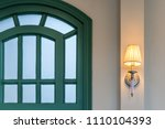 modern wall lamp with green... | Shutterstock . vector #1110104393