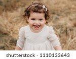 sweet toddler girl standing on...   Shutterstock . vector #1110133643