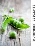 Fresh Green Peas On Wooden...