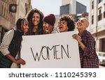 group of laughing demonstrators ... | Shutterstock . vector #1110245393