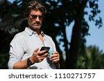 business man using mobile in... | Shutterstock . vector #1110271757