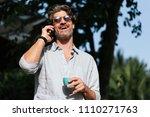 business man using mobile in... | Shutterstock . vector #1110271763