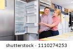 positive couple chooses... | Shutterstock . vector #1110274253