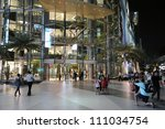 BANGKOK - MARCH 27: Shoppers visit Siam Paragon mall in Siam Square on March 27, 2012 in Bangkok, Thailand. With 300,000 sq m of retail space Siam Paragon is one of the largest malls in the world. - stock photo