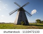 lithuanian windmill with clouds ... | Shutterstock . vector #1110472133
