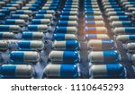 blue and white capsules pill in ... | Shutterstock . vector #1110645293