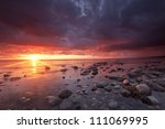 Beautiful moody sunrise with stormclouds, southern of Sweden - stock photo