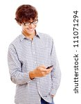 Young smiling latin man in black glasses enjoying cell phone. Isolated on white background, mask included - stock photo