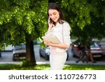 the girl is talking on the... | Shutterstock . vector #1110726773