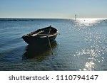 small wooden fishing boat... | Shutterstock . vector #1110794147
