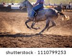 cowboy riding competing in... | Shutterstock . vector #1110799253