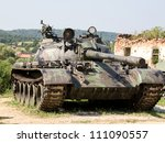 Old Army Tank In Front Of Ruins