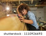 happy young woman working on... | Shutterstock . vector #1110926693