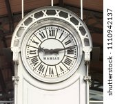 Small photo of PARIS / FRANCE - SEPTEMBER 2nd, 2014: Clock on Grande Halle de la Vilette market hall. Black fingers and numbers on white background. Time on clock: 9h13