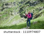 young happy famele hiker with... | Shutterstock . vector #1110974807