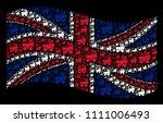 waving uk state flag on a black ... | Shutterstock .eps vector #1111006493