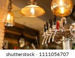 beer tap in barse for bottling... | Shutterstock . vector #1111056707