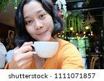 selfie asian woman  drinking...   Shutterstock . vector #1111071857