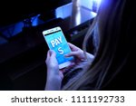 woman using mobile with the pay ... | Shutterstock . vector #1111192733