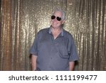 man posing in a photo booth. a...   Shutterstock . vector #1111199477
