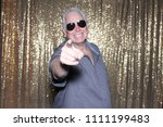 man posing in a photo booth. a...   Shutterstock . vector #1111199483