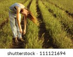 beautiful girl in a summer field - stock photo