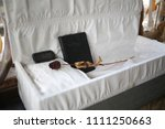 dried red rose and a holy bible ... | Shutterstock . vector #1111250663