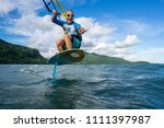 professional kiter t rides by... | Shutterstock . vector #1111397987