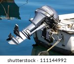 outboard engine on the plastic boat - stock photo