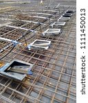 Small photo of KUALA LUMPUR, MALAYSIA -MAY 14, 2018: Pre-stress cable tendons and anchor part of the pre-stressed concrete. It is a construction technology to get better concrete slab quality with larger span.